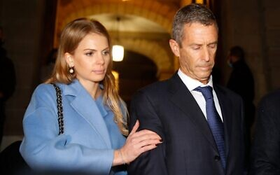Israeli diamond magnate Beny Steinmetz  is comforted by lawyer Camille Haab after his conviction for corruption linked to mining deals in Guinea, in Geneva on January 22, 2021. Steinmetz was sentenced to five years in jail. (STEFAN WERMUTH / AFP)