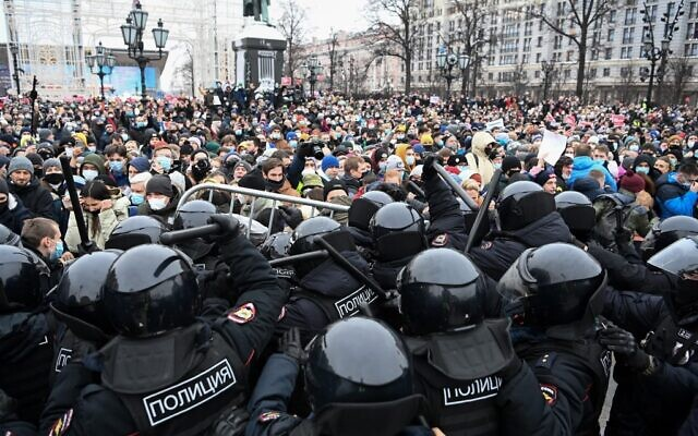 Protesters clash with riot police during a rally in support of jailed opposition leader Alexei Navalny in downtown Moscow, Russia, January 23, 2021. (Kirill Kudryavtsev/AFP)