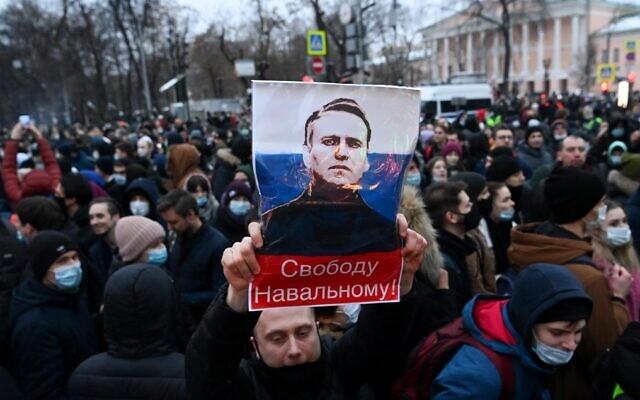 "Russian protesters march in support of jailed opposition leader Alexei Navalny in downtown Moscow on January 23, 2021. The placard with an image of the Kremlin critic reads ""Freedom to Navalny!"" (Kirill Kudryavtsev/AFP)"