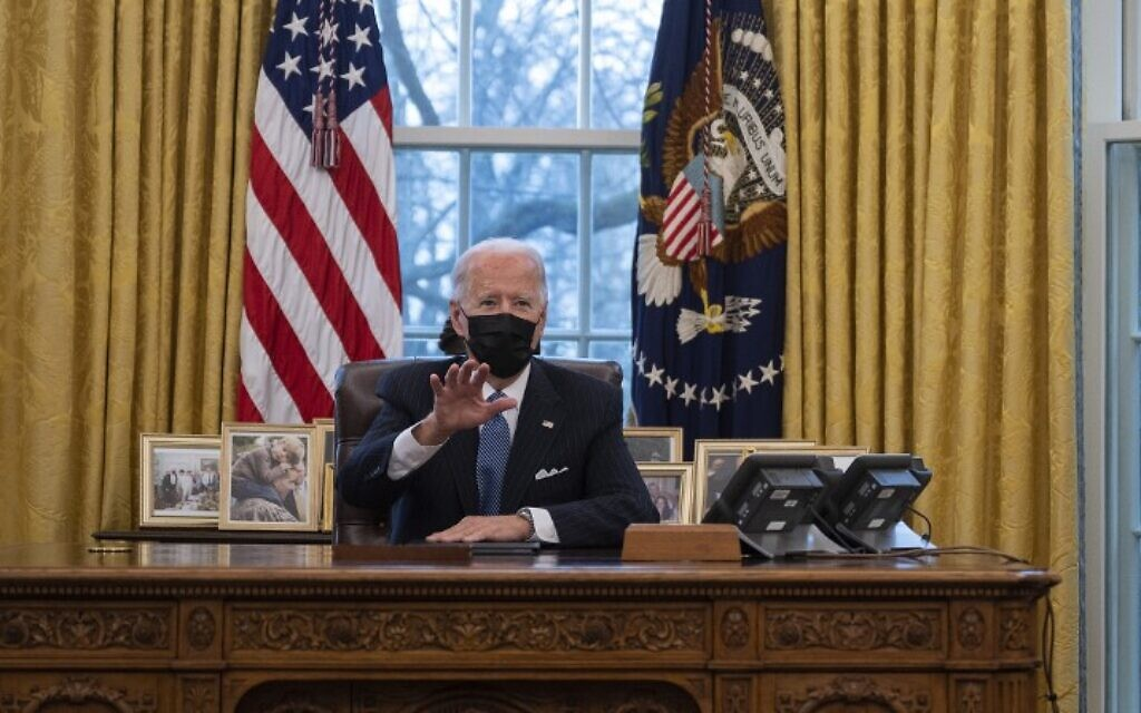US President Joe Biden in the Oval Office of the White House on January 25, 2021. (Jim Watson/AFP)