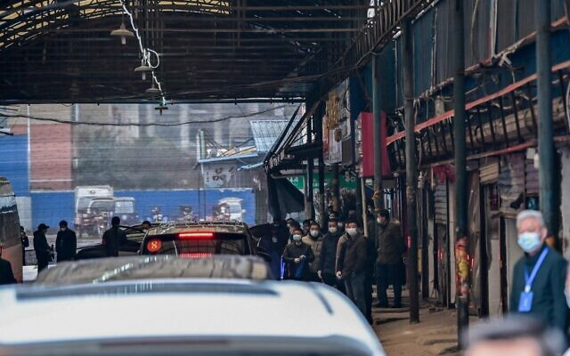 Cars transporting members of the World Health Organization (WHO) team, investigating the origins of the COVID-19 coronavirus, arrive at the closed Huanan Seafood wholesale market in Wuhan, China's central Hubei province on January 31, 2021. Hector RETAMAL/AFP)