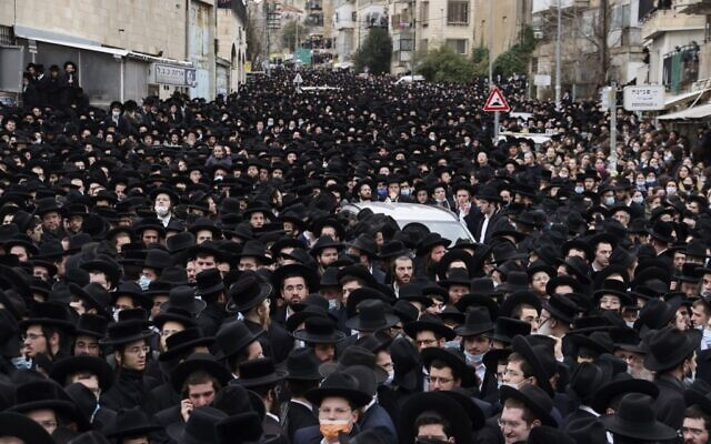 Illustrative: Thousands of ultra-Orthodox Jews attend a funeral procession for the head of the Brisk Yeshiva, Rabbi Meshulam Dovid Soloveitchik in Jerusalem on January 31, 2021, following his passing aged 99, due to months-long illness compounded by the coronavirus. (Menahem Kahana/AFP)