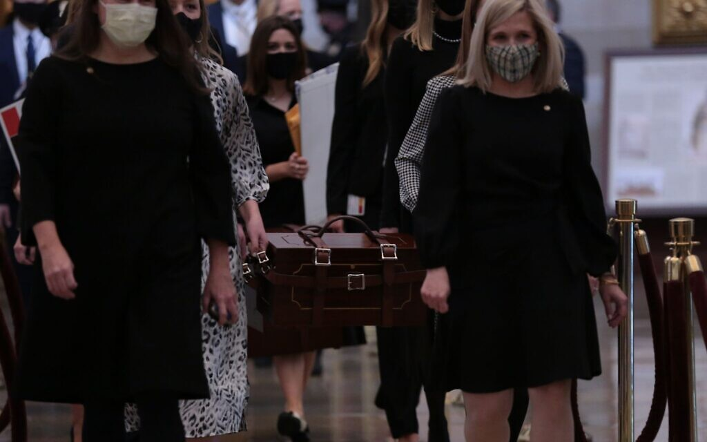 US Senate staff carry boxes containing state Electoral College votes at the U.S. Capitol, January 6, 2021. Brennan Leach, a Northwestern student whose photo went viral, is second from left, partially obscured. (Cheriss May/Getty Images/ via JTA/ SUE)