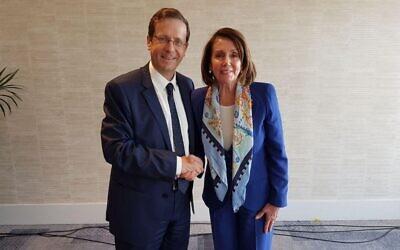 Then-opposition leader Isaac Herzog greets Nancy Pelosi in Tel Aviv on March 26, 2018. (Isaac Herzog's Twitter feed via JTA)