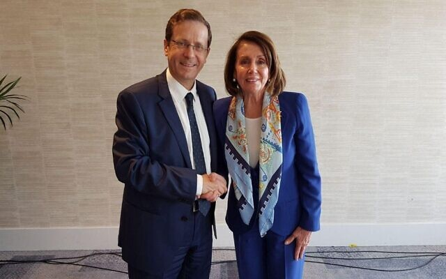 Then-opposition leader Isaac Herzog greets Nancy Pelosi in Tel Aviv on March 26, 2018. (Isaac Herzog's Twitter feed via JTA)