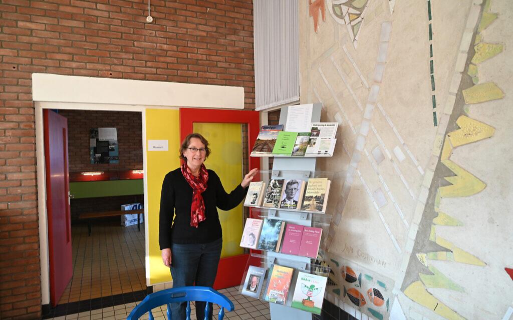 Hanneke Rozema greets visitors at the De Duikelaar museum in Nieuwlande, the Netherlands on January 25, 2021. (Cnaan Liphshiz/ JTA)