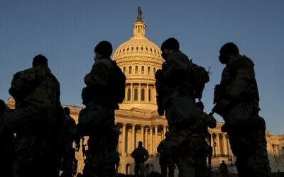 Members of the National Guard gather outside the U.S. Capitol on January 13, 2021 in Washington, DC. (Stefani Reynolds/Getty Images/AFP)