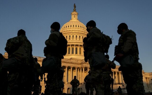 Members of the National Guard gather outside the US Capitol on January 13, 2021 in Washington, DC. (Stefani Reynolds/Getty Images/AFP)