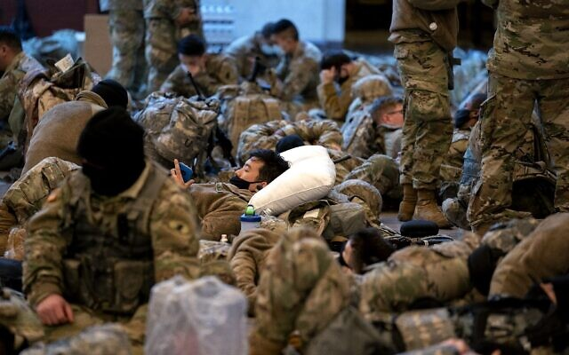 WASHINGTON, DC - JANUARY 13: Members of the National Guard sleep in the Visitor Center of the U.S. Capitol on January 13, 2021 in Washington, DC (Stefani Reynolds/Getty Images/AFP