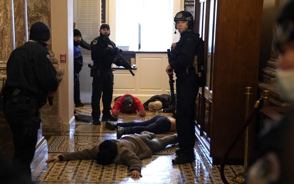 US Capitol Police detain protesters outside the House Chamber during a joint session of Congress on January 6, 2021 in Washington. (Drew Angerer/Getty Images/AFP)