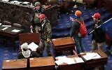 Pro-Trump protesters enter the Senate Chamber on January 6, 2021 in Washington, DC. (Win McNamee/Getty Images/AFP
