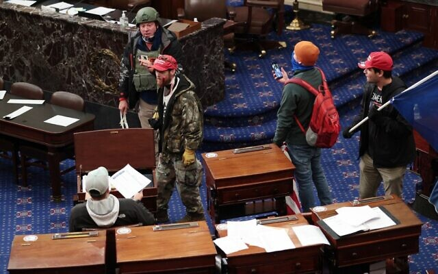 Pro-Trump protesters enter the Senate Chamber on January 06, 2021 in Washington, DC. (Win McNamee/Getty Images/AFP