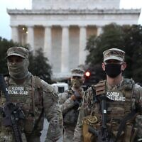 Members of the Florida National Guard stand guard outside of the Lincoln Memorial on January 16, 2021 in Washington, DC. (Joe Raedle/Getty Images/AFP)