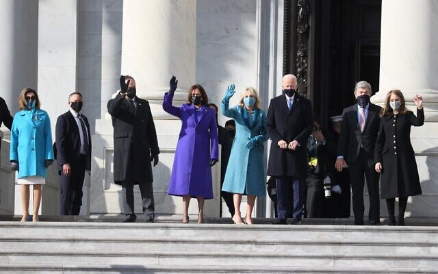 From left to right: Doug Emhoff, US Vice President-elect Kamala Harris, Jill Biden and President-elect Joe Biden wave as they arrive on the East Front of the US Capitol for the inauguration on January 20, 2021, in Washington. (Joe Raedle/Getty Images/AFP)
