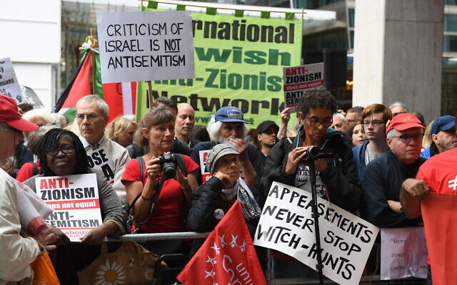 Activists outside a meeting of the Labour National Executive Committee in London with signs protesting the IHRA definition of anti-Semitism, September 4, 2018. (Stefan Rousseau/PA Images via Getty Images/ via JTA /SUE)