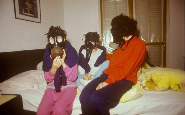 An Israeli family wears gas masks for fear of a chemical weapon attack during the 1991 Gulf War. (Michael Tzarfati/Defense Ministry Archive)