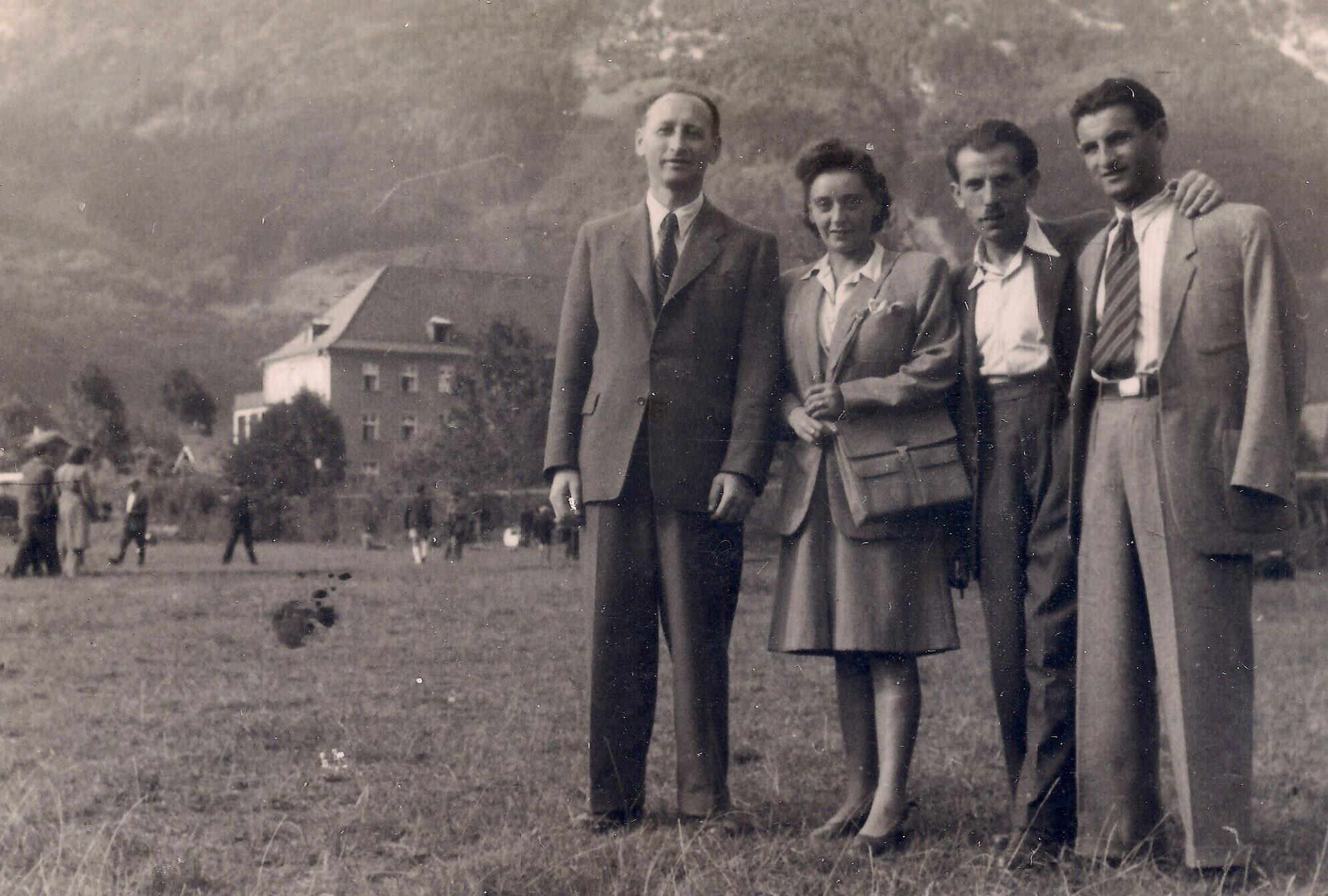 Regina and Joseph Dichek, at right, with the Bad Reichenhall displaced persons camp in the background, Germany, circa 1946-1949. The clothing may not have fit well, but it was well-made and clean, and in most photos Regina and Joseph Dichek are seen wearing different outfits, thanks to the generous donations of the JDC and other relief organizations. (Courtesy Bernard Dichek)