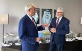 Bank Hapoalim CEO Dov Kotler, right, meets with CEO of the National Bank of Bahrain Jean-Christophe Durand in Manama, Bahrain in Nov. 2020 (Courtesy)