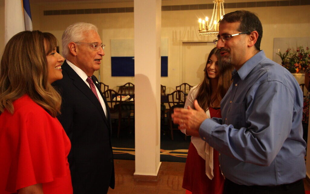 Tammy Friedman, left, Ambassador David Friedman, second left, and former ambassador Dan Shapiro, right, at the ambassador's residence in Herzliya in 2017. (US Embassy)