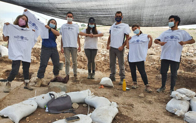 Students from the Hanaton pre-military preparatory program work on the excavation of an Islamic period building in which a late 5th century CE Greek inscription, 'Christ born of Mary,' was found in secondary use, in the village of et-Taiyiba (Taybeh) in the Jezreel Valley. (Einat Ambar-Armon/Israel Antiquities Authority)