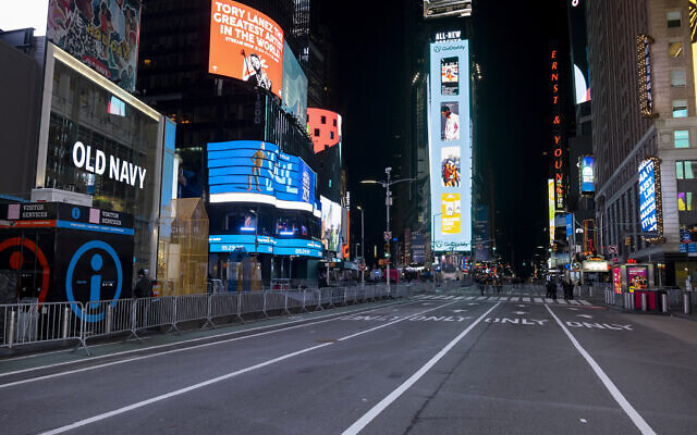 Seventh Avenue is mostly empty during what would normally be a Times Square packed with people, December 31, 2020, in New York, as celebrations have been truncated this New Year's Eve due to the ongoing pandemic. (AP Photo/Craig Ruttle)