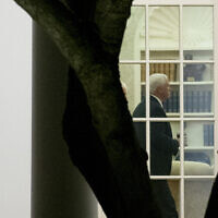 US Vice President Mike Pence walks through the Oval Office, Monday, Jan. 4, 2021 (AP Photo/Andrew Harnik)