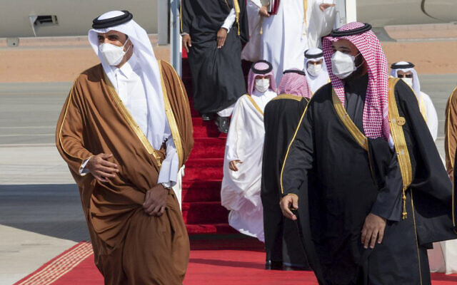 Saudi Arabia's Crown Prince Mohammed bin Salman, right, welcomes Qatar's Emir Sheikh Tamim bin Hamad al-Thani upon his arrival to attend the Gulf Cooperation Council's 41st Summit in Al-Ula, Saudi Arabia, January 5, 2021. (Saudi Royal Court via AP)