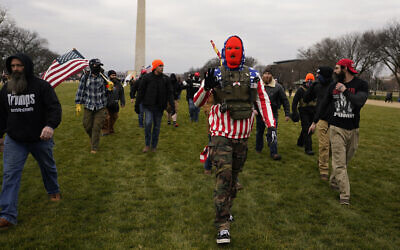 People march with those who claim they are members of the Proud Boys extremist group at a rally in support of US President Donald Trump in Washington, January 6, 2021. (AP Photo/Carolyn Kaster)