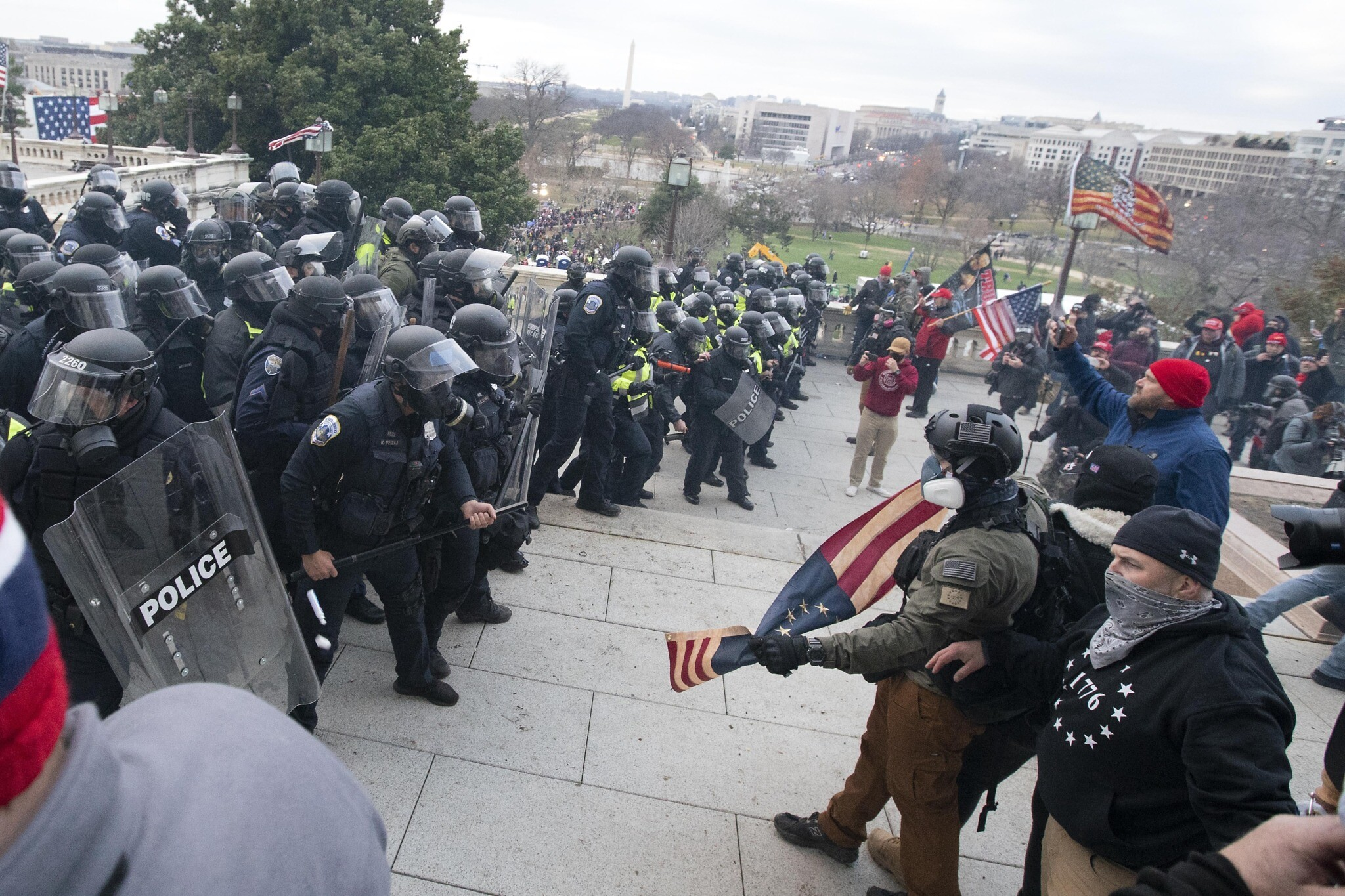 US Capitol Police push back demonstrators who were trying to enter the US Capitol on January 6, 2021, in Washington. (AP Photo/Jose Luis Magana)