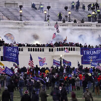 Violent protesters, loyal to US President Donald Trump, storm the Capitol on January 6, 2021, in Washington.  (AP/ John Minchillo)