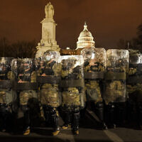 District of Columbia National Guard stand outside the Capitol, Jan. 6, 2021, after a day of rioting protesters. (AP Photo/John Minchillo)