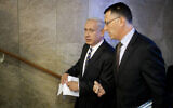 In this August 26, 2012, photo, Prime Minister Benjamin Netanyahu, left, speaks to then Education Minister Gideon Sa'ar as they arrive at the weekly cabinet meeting in Jerusalem. (AP Photo/Uriel Sinai/Getty Images, Pool, File)