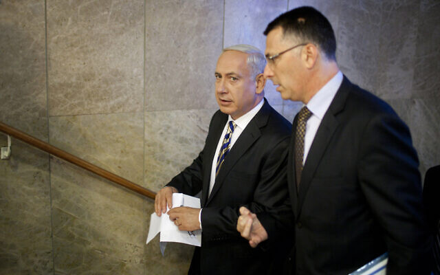 In this August 26, 2012, photo, Prime Minister Benjamin Netanyahu, left, speaks to then-Education Minister Gideon Sa'ar as they arrive at the weekly cabinet meeting in Jerusalem. (AP Photo/Uriel Sinai/Getty Images, Pool, File)