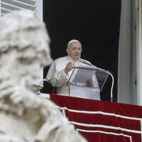 Pope Francis delivers his message during the Angelus noon prayer from the window of his studio overlooking St.Peter's Square, on the Immaculate Conception day, at the Vatican, December 8, 2020. (AP Photo/Andrew Medichini, file)