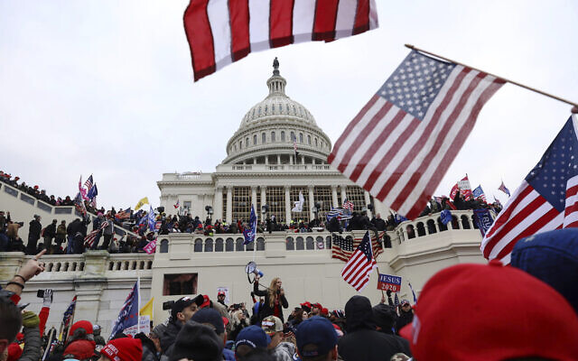 In this January 6, 2021 photo, supporters of President Donald Trump gather outside the US Capitol in Washington. (AP Photo/Shafkat Anowar)