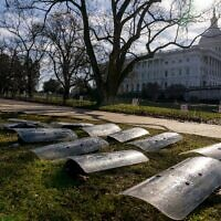 The dome of the US Capitol building is visible as riot gear is laid out on a field on Capitol Hill in Washington, January 13, 2021. (AP Photo/Andrew Harnik)