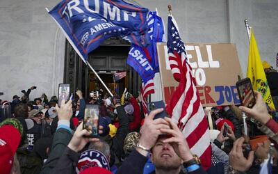 Trump supporters gather outside the US Capitol in Washington, January 6, 2021. (AP Photo/John Minchillo, File)