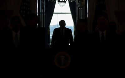 In this Jan. 8, 2020, photo US President Donald Trump arrives to address the nation from the White House on the ballistic missile strike that Iran launched against Iraqi air bases housing US troops in Washington (AP Photo/ Evan Vucci)