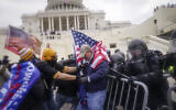 Rioters try to break through a police barrier at the Capitol in Washington, January 6, 2020. (AP Photo/John Minchillo, File)