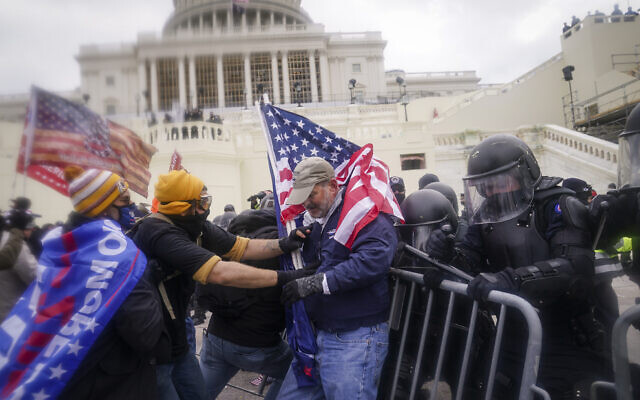 Rioters try to break through a police barrier at the US Capitol in Washington