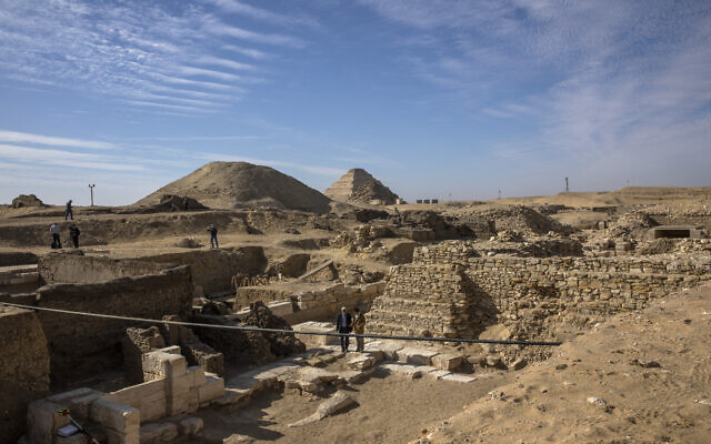 CORRECTS DAY OF WEEK TO SUNDAY -- The excavation site where Egyptian archaeologist Zahi Hawass and his team unearthed a trove of ancient coffins, artifacts, and skulls in a vast necropolis south of Cairo, Egypt, January 17, 2021, in Saqqara, south of Cairo, Egypt. (AP Photo/Nariman El-Mofty)