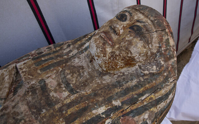 An ancient coffin is on display that Egyptian archaeologist Zahi Hawass and his team unearthed in a vast necropolis filled with burial shafts, coffins and mummies dating back to the New Kingdom 3000 BC, January 17, 2021, in Saqqara, south of Cairo, Egypt. (AP Photo/Nariman El-Mofty)