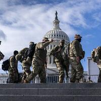 National Guard troops reinforce security around the US Capitol ahead of the inauguration of President-elect Joe Biden and Vice President-elect Kamala Harris, Sunday, Jan. 17, 2021, in Washington. (AP Photo/J. Scott Applewhite)