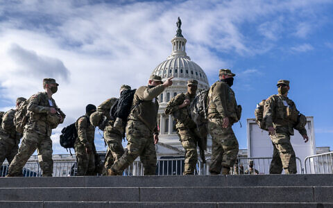 National Guard troops reinforce security around the US Capitol ahead of the inauguration of President-elect Joe Biden and Vice President-elect Kamala Harris, Sunday, Jan. 17, 2021, in Washington. (AP Photo/J. Scott Applewhite)