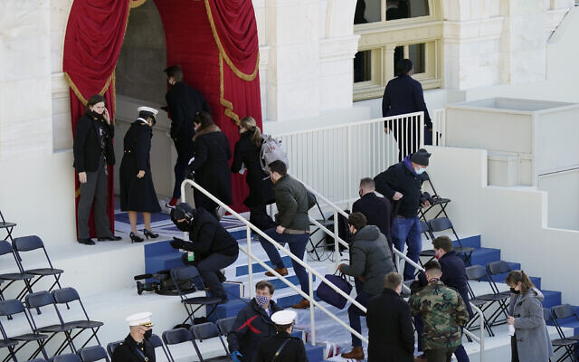 People evacuate from the West Front of the US Capitol during a rehearsal the 59th Presidential Inauguration at the US Capitol in Washington, January 18, 2021. (Carolyn Kaster/AP)