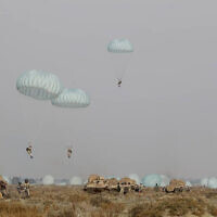 This photo released on January 19, 2021, by the Iranian Army, shows paratroopers parachuting during a military drill. (Iranian Army via AP)