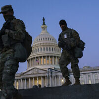 US National Guard troops reinforce the security zone before US President-elect Joe Biden is sworn in, on Capitol Hill in Washington, January 19, 2021. (J. Scott Applewhite/AP)