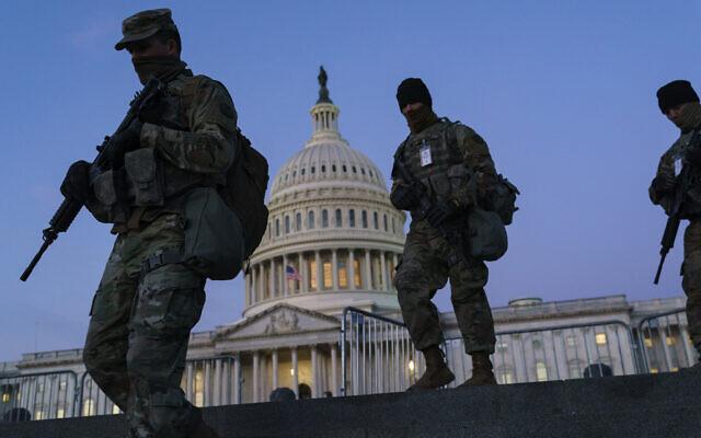 US National Guard troops reinforce the security zone before US President-elect Joe Biden is sworn in, on Capitol Hill in Washington, January 19, 2021. (J. Scott Applewhite/AP)