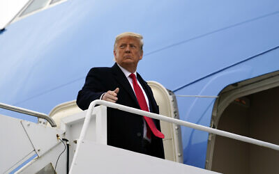 US President Donald Trump gestures as he boards Air Force One upon arrival at Valley International Airport, in Harlingen, Texas, January 12, 2021. (AP Photo/Alex Brandon, File)