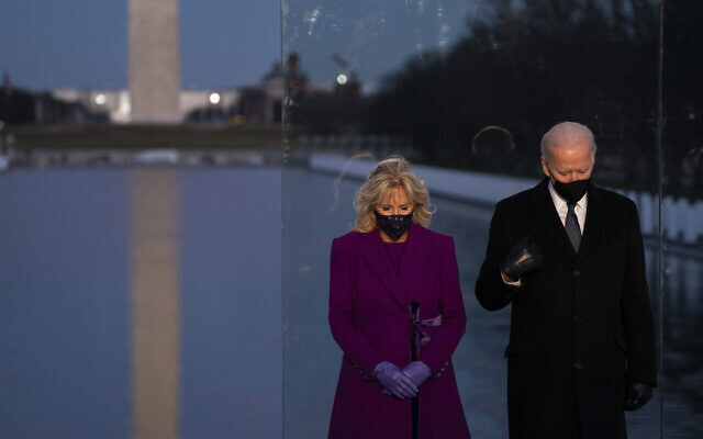 US President-elect Joe Biden and his wife Jill Biden participate in a COVID-19 memorial event at the Lincoln Memorial Reflecting Pool on Jan. 19, 2021, in Washington. (AP/Evan Vucci)